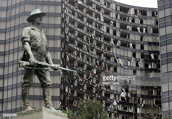 The destroyed Hyatt Regency hotel is seen next to statue honoring SpanishAmerican War veterans after Hurricane Katrina hit the city August 29 2005 in...