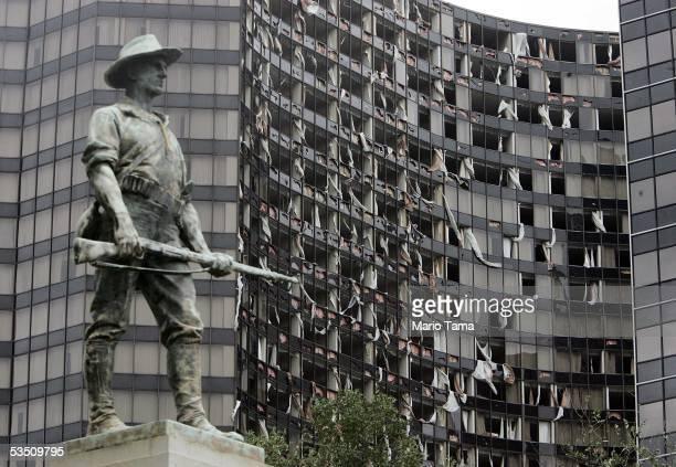 The destroyed Hyatt Regency hotel is seen next to statue honoring SpanishAmerican War veterans after Hurricane Katrina hit the city August 29 2005 in...