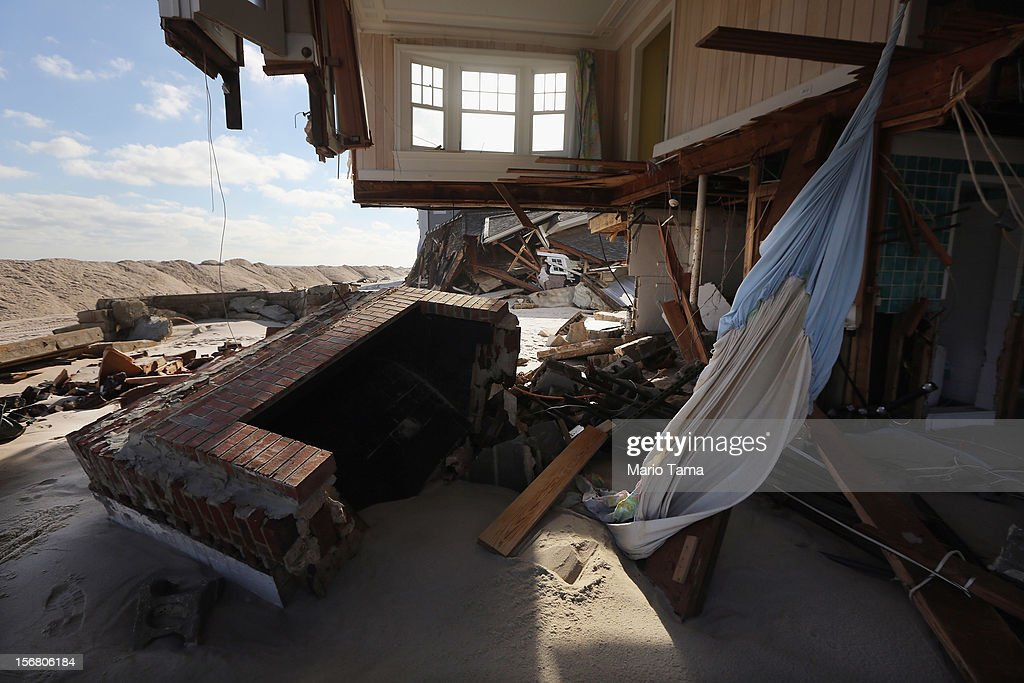 The destroyed remains of a home sit in the sand on November 21, 2012 in Mantoloking, New Jersey. Mantoloking was one of the hardest hit areas by Superstorm Sandy.