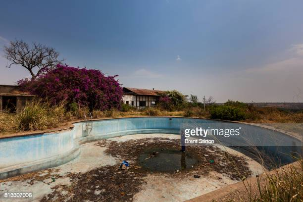 The destroyed remains of the Rwindi hotel once a popular resort in this part of Virunga National Park now a shell tacked on the ICCN conservation...