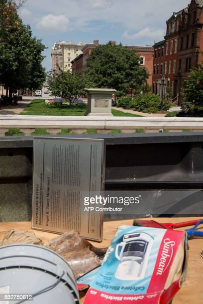 The detail sign at the former Roger B Taney monument in Mount Vernon Place is viewed in Baltimore Maryland after it was removed by the city on August...