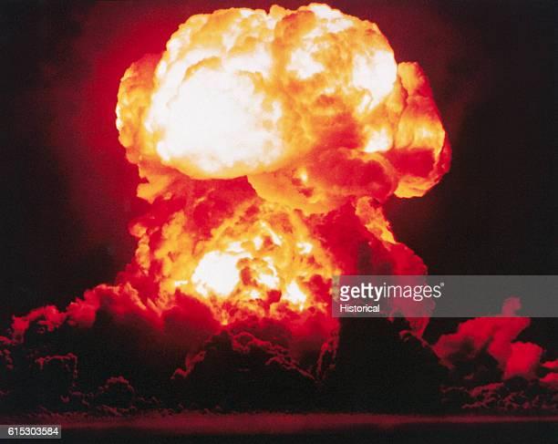 The detonation of the atomic bomb nicknamed 'Smokey' as part of Operation PLUMBBOB in the Nevada desert 1957