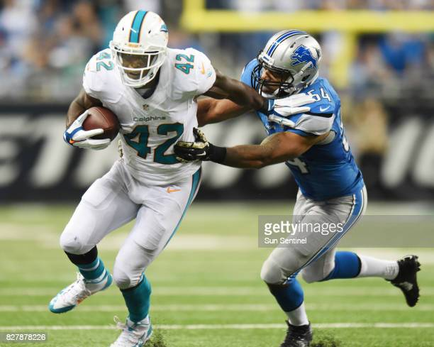 The Detroit Lions' DeAndre Levy right tracks down the Miami Dolphins' Charles Clay on November 9 at Ford Field in Detroit
