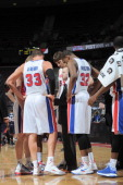 The Detroit Pistons gather around Head Coach Lawrence Frank during the game between the Detroit Pistons and the Atlanta Hawks on February 25 2013 at...
