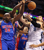 The Detroit Pistons' Joel Anthony Anthony Tolliver and Spencer Dinwiddie conspire to block the shot of the Orlando Magic's Nikola Vucevic at the...