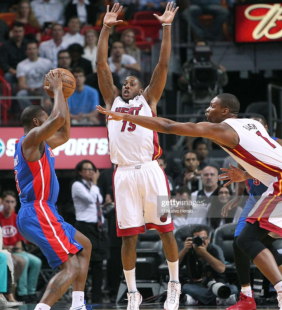 The Detroit Pistons' Rodney Stuckey, left, looks to pass against Miami Heat defenders Mario Chalmers, center, and Chris Bosh (1) in the first quarter at the American Airlines Arena in Miami, Florida, Friday, March 22, 2013. The Heat defeated the Pistons, 103-89.