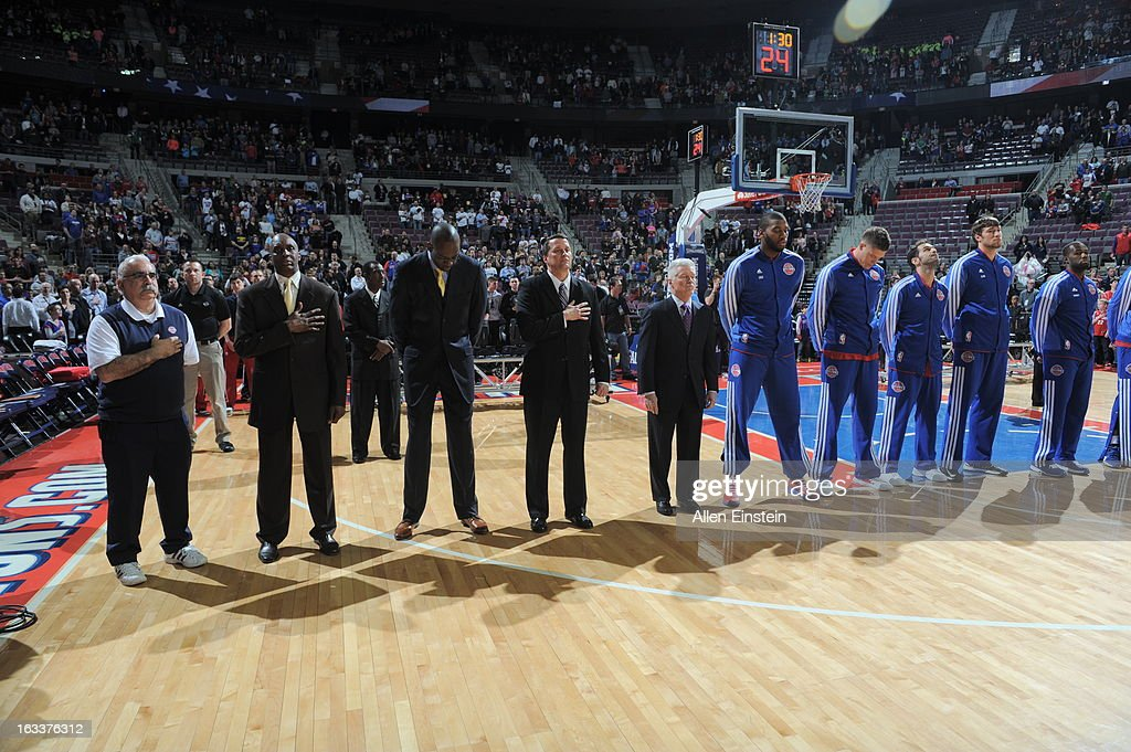 The Detroit Pistons team and staff line lines up during the game between the Detroit Pistons and the Dallas Mavericks on March 8, 2013 at The Palace of Auburn Hills in Auburn Hills, Michigan.