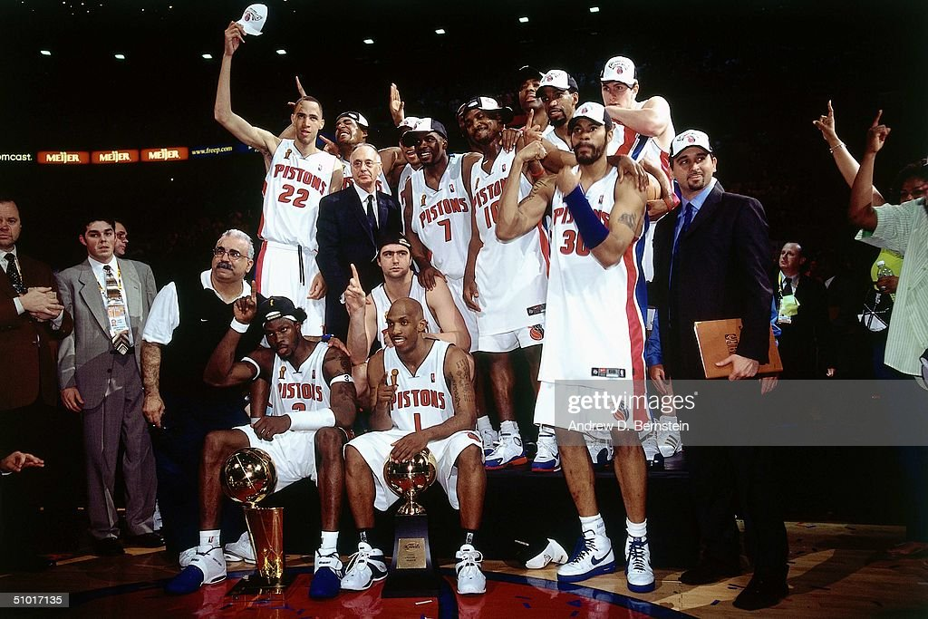 The Detroit Pistons team poses for a picture after their win over the Los Angeles Lakers in game five of the 2004 NBA Finals at The Palace of Auburn Hills on June 15, 2004 in Auburn Hills, Michigan.