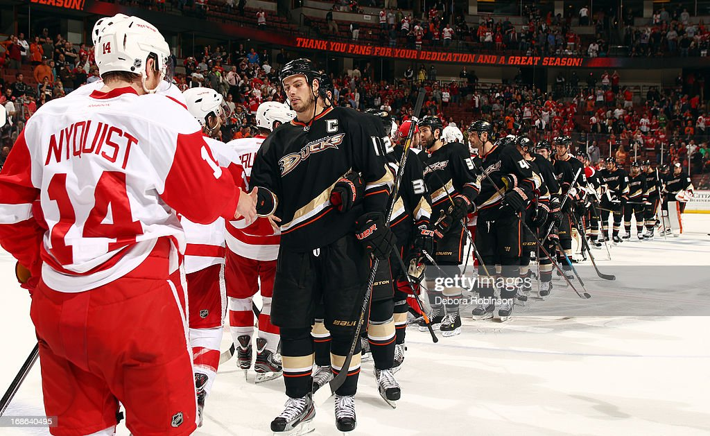 The Detroit Red Wings and the Anaheim Ducks participate in the post game player handshake after the Red Wings 3-2 victory in Game Seven of the Western Conference Quarterfinals during the 2013 NHL Stanley Cup Playoffs at Honda Center on May 12, 2013 in Anaheim, California.