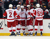The Detroit Red Wings celebrate a second period goal by Justin Abdelkader against the New York Islanders at the Barclays Center on January 25 2016 in...
