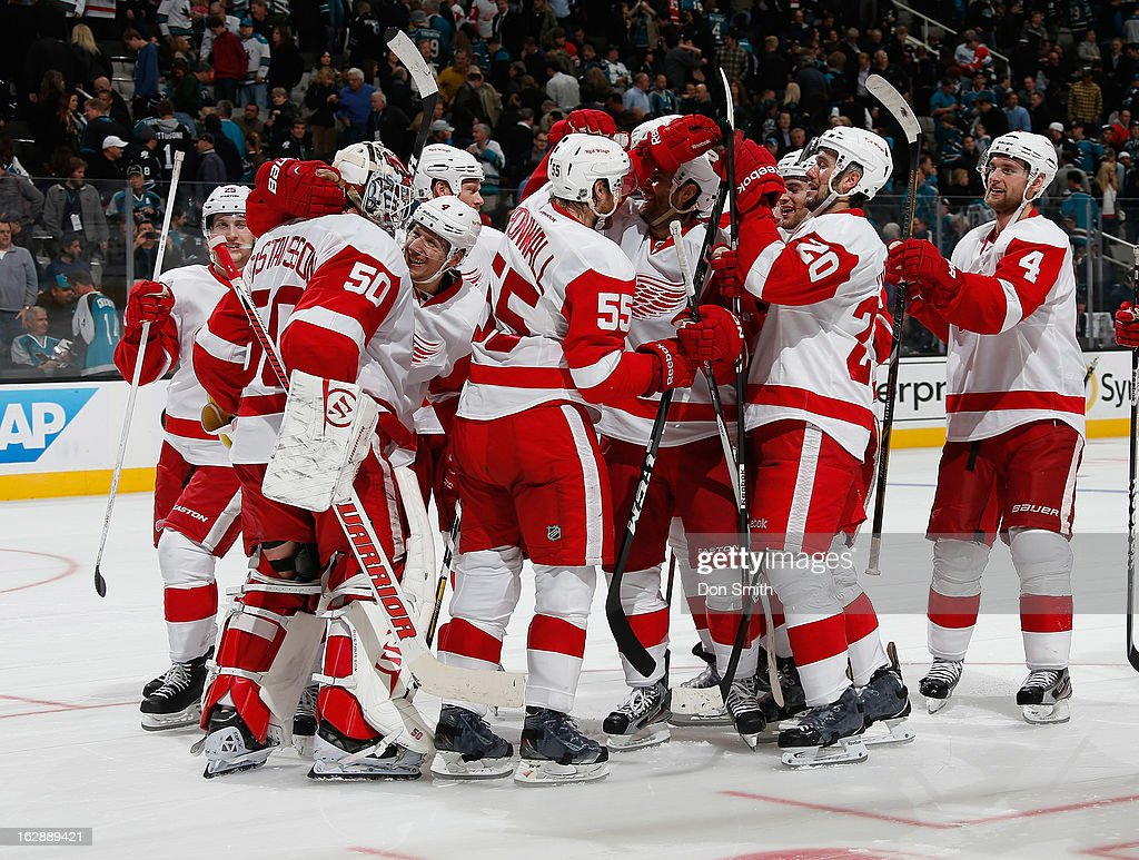 The Detroit Red Wings celebrate a victory against the San Jose Sharks during an NHL game on February 28, 2013 at HP Pavilion in San Jose, California.