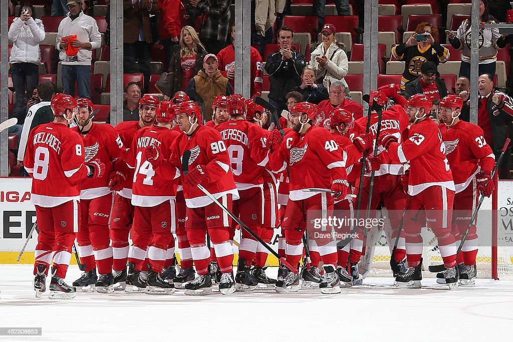 The Detroit Red Wings celebrate after defeating the Boston Bruins 6-1 after an NHL game at Joe Louis Arena on November 27, 2013 in Detroit, Michigan.