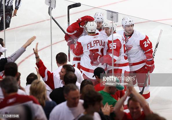 The Detroit Red Wings celebrate after Valtteri Filppula scored a second period goal against the Phoenix Coyotes in Game Three of the Western...