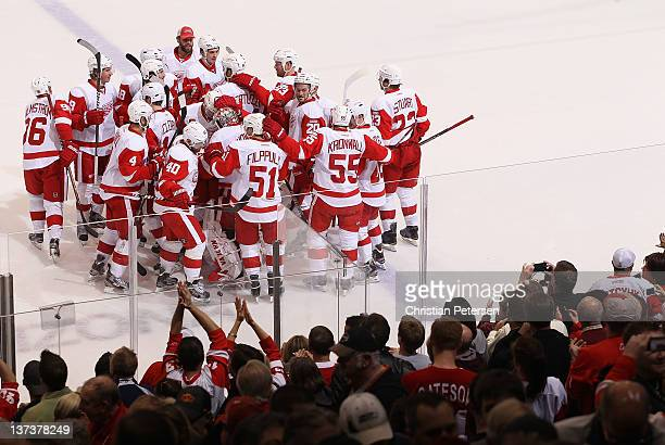 The Detroit Red Wings celebrate around goaltender Jimmy Howard after Todd Bertuzzi scored the game winning shoot out goal against the Phoenix Coyotes...
