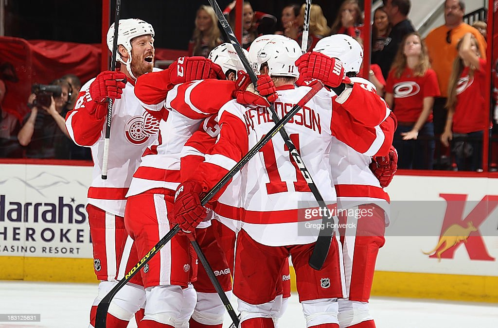The Detroit Red Wings celebrate victory over the Carolina Hurricanes on October 4, 2013 in the home opener at PNC Arena in Raleigh, North Carolina.