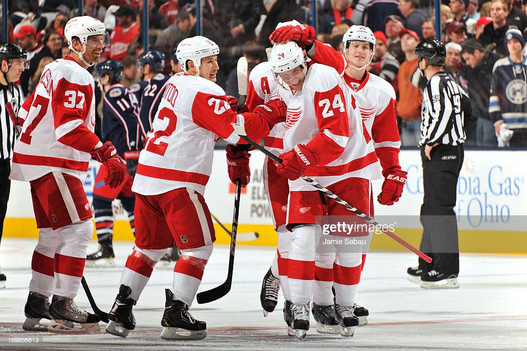 The Detroit Red Wings celebrate with teammate Damien Brunner #24 after his shootout goal against the Columbus Blue Jackets gave Detroit a 4-3 win over Columbus on January 21, 2013 at Nationwide Arena in Columbus, Ohio.