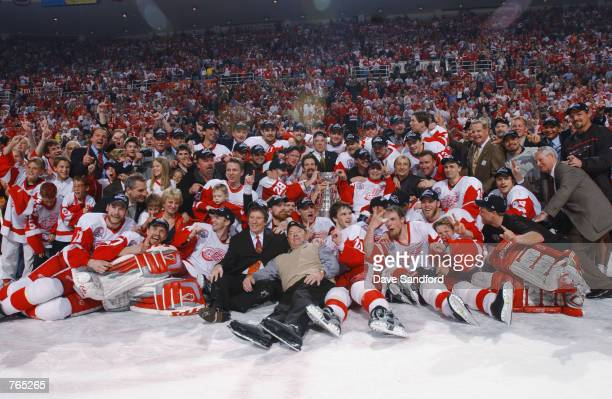 The Detroit Red Wings pose for a team photo with the Stanley Cup after defeating the Carolina Hurricanes during game five of the NHL Stanley Cup...