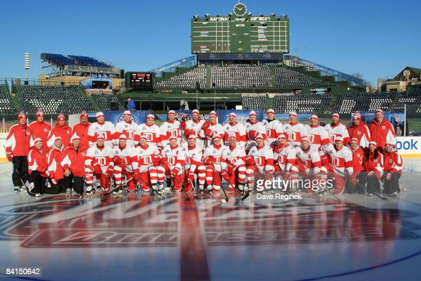 The Detroit Red Wings pose on the ice during practice a day before playing against the Chicago Blackhawks in the NHL Winter Classic at Wrigley Field...