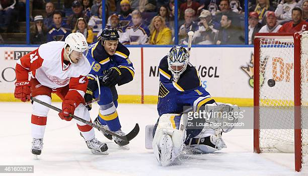 The Detroit Red Wings' Tomas Tatar left scores past St Louis Blues goaltender Brian Elliott right in the second period on Thursday Jan 15 at the...
