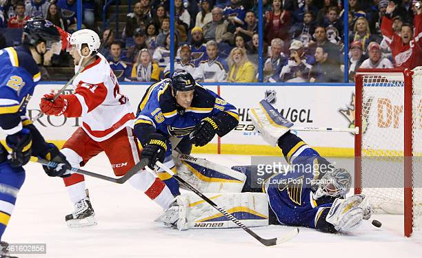 The Detroit Red Wings' Tomas Tatar left turns to celebrate after scoring past St Louis Blues goaltender Brian Elliott right in the second period on...
