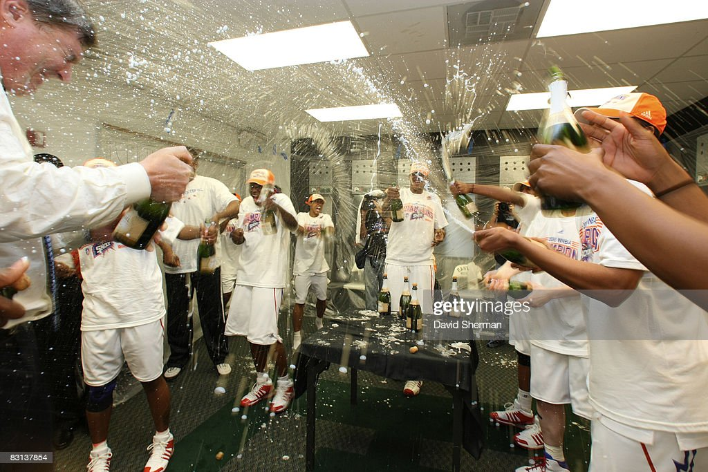 The Detroit Shock celebrates in the lockerroom after winning Game Three of the WNBA Finals against the San Antonio Silver Star on October 5 2008 at...