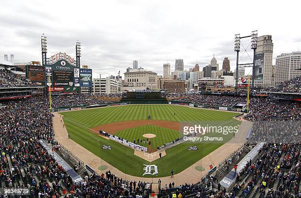 The Detroit Tigers and Cleveland Indians line up for the performance of the National Anthem during Opening Day on April 9 2010 at Comerica Park in...