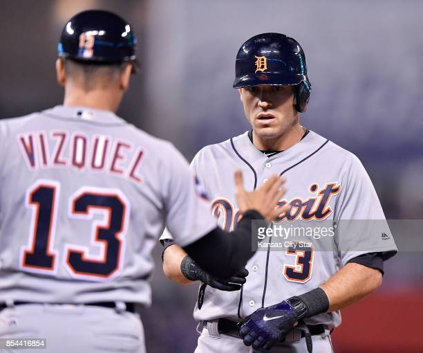 The Detroit Tigers' Ian Kinsler is congratulated by first base coach Omar Vizquel after hitting an RBI single in the third inning against the Kansas...