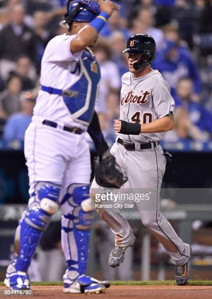 The Detroit Tigers' JaCoby Jones right scores past Kansas City Royals catcher Salvador Perez on a single by Ian Kinsler in the third inning at...
