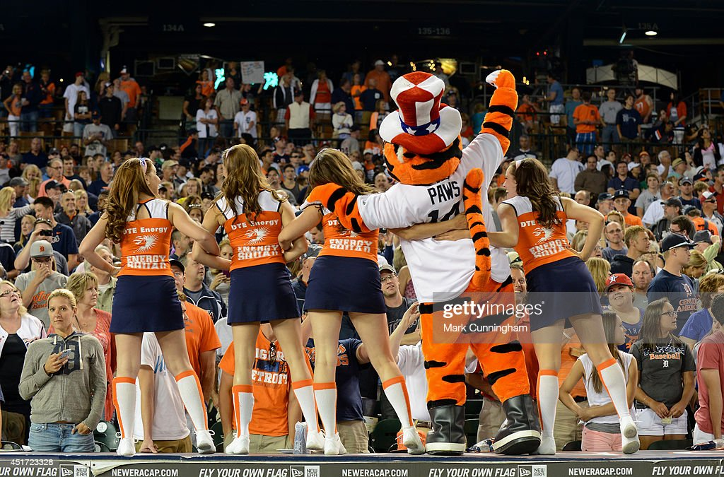 The Detroit Tigers mascot Paws and members of the Energy Squad entertain the crowd during the game against the Tampa Bay Rays at Comerica Park on July 4, 2014 in Detroit, Michigan. The Rays defeated the Tigers 6-3.