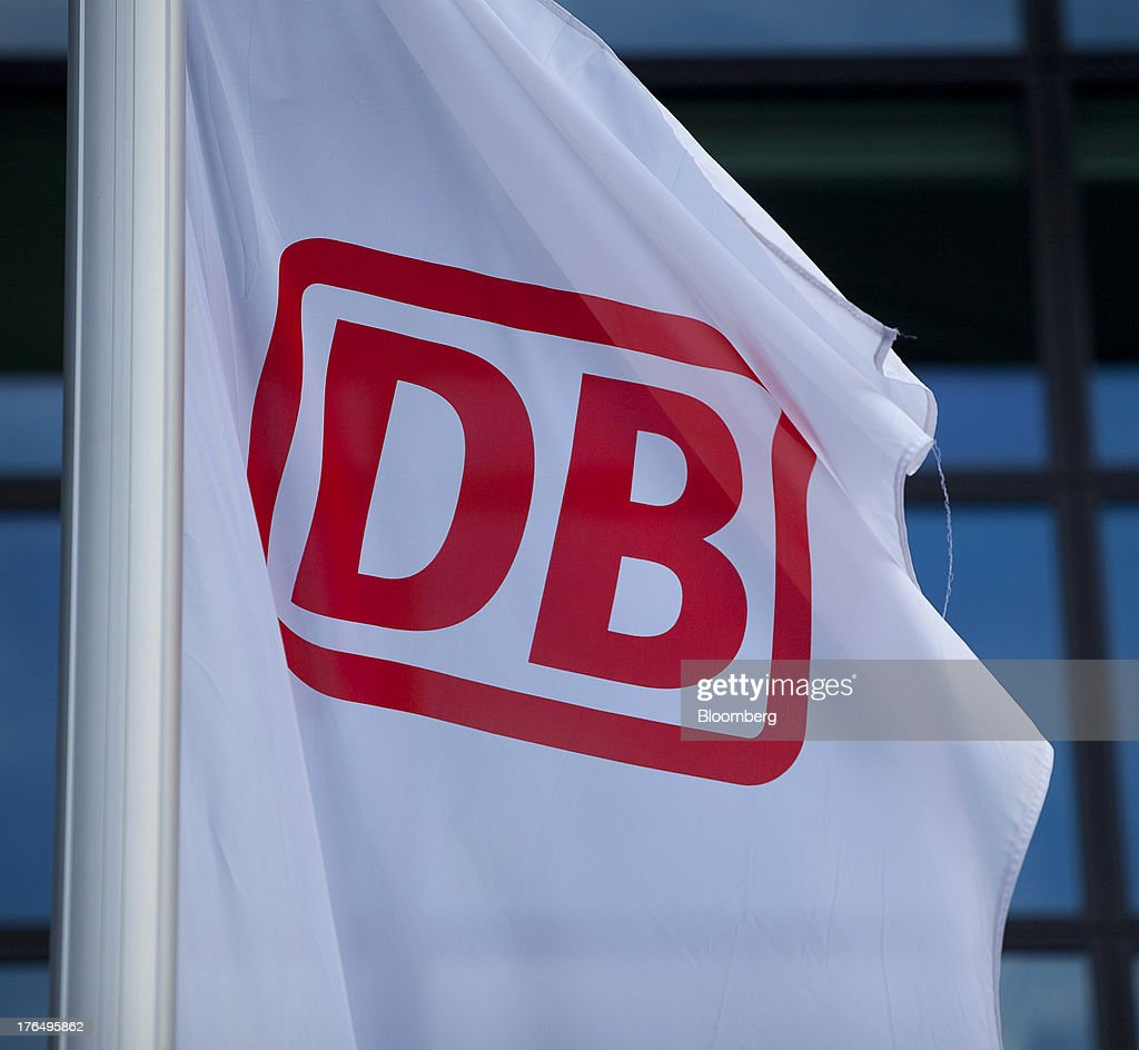 The Deutsche Bahn AG logo sits on a banner flying outside Berlin Central Station, also known as Hauptbahnhof, in Berlin, Germany, on Tuesday, Aug. 13, 2013. German gross domestic product rose 0.7 percent from the first quarter and the French economy expanded 0.5 percent, the countries' national statistics offices said today. Photographer: Krisztian Bocsi/Bloomberg via Getty Images