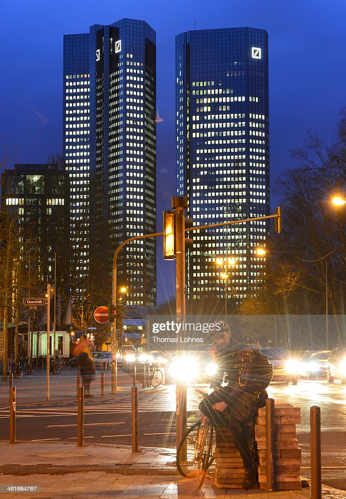 The Deutsche Bank AG headquarters stand illuminated in the twilight on January 09, 2014 in Frankfurt am Main, Germany. Many of Germany's biggest banks will be announcing their financial results for 2013 in the coming weeks.