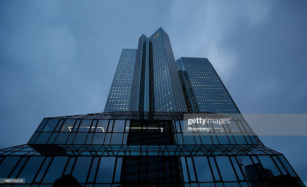The Deutsche Bank AG headquarters stands ahead of a news conference to announce the bank's results in Frankfurt, Germany, on Wednesday, Jan. 29, 2014. Deutsche Bank AG, Germany's biggest bank, cut total compensation for employees at its investment bank 23 percent in the fourth quarter as a slide in revenue contributed to a loss for the period. Photographer: Ralph Orlowski/Bloomberg via Getty Images