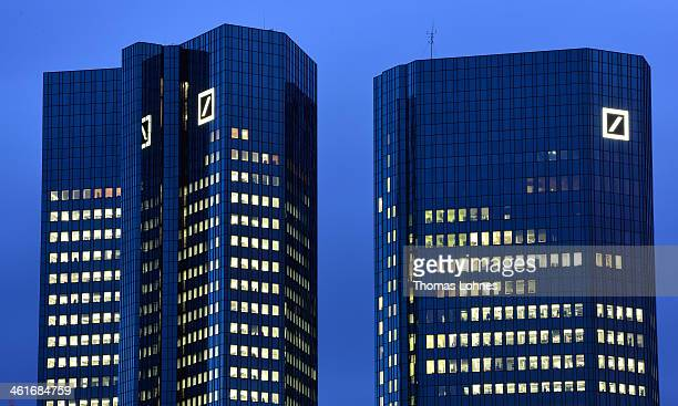 The Deutsche Bank AG headquarters stands illuminated in the twilight on January 09 2014 in Frankfurt am Main Germany Many of Germany's biggest banks...