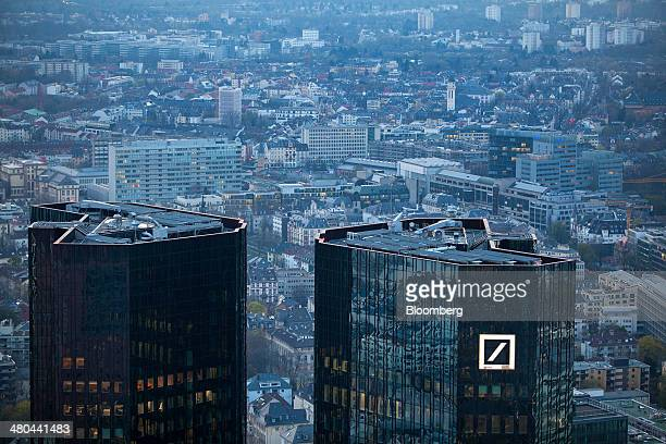 The Deutsche Bank AG headquarters stands in front of commercial and residential property in Frankfurt Germany on Monday March 24 2014 German business...