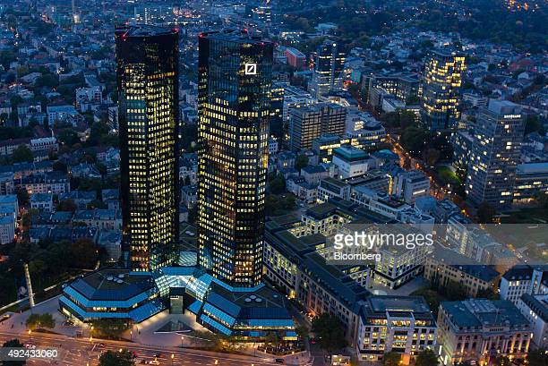 The Deutsche Bank AG logo sits illuminated on the bank's headquarter skyscraper offices at night in Frankfurt Germany on Monday Oct 13 2015 Deutsche...