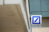 The Deutsche Bank AG logo sits on a sign outside a branch in Boblingen Germany on Monday July 25 2016 Deutsche Bank Chief Executive Officer John...