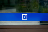 The Deutsche Bank AG logo sits on a window of a branch in Boblingen Germany on Monday July 25 2016 Deutsche Bank Chief Executive Officer John Cryan...