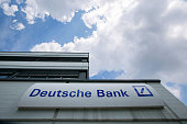 The Deutsche Bank AG logo sits on the exterior of a branch in Boblingen Germany on Monday July 25 2016 Deutsche Bank Chief Executive Officer John...