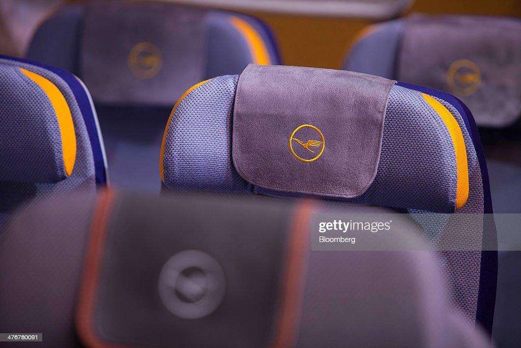 The Deutsche Lufthansa AG logo sits on the headrests of passenger seating at the ITB Berlin tourism fair at Messe Berlin exhibition center in Berlin, Germany, on Wednesday, March 5, 2014. Archaic rules, taxes as high as those imposed on alcohol and an infrastructure deficit, especially in Asia, are curbing the aviation industry's growth, the International Air Transport Association said. Photographer: Krisztian Bocsi/Bloomberg via Getty Images