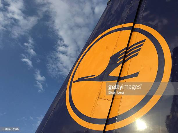 The Deutsche Lufthansa AG logo sits on the tail fin of a passenger jet as it sits on the tarmac at Frankfurt Airport operated by Fraport AG in...