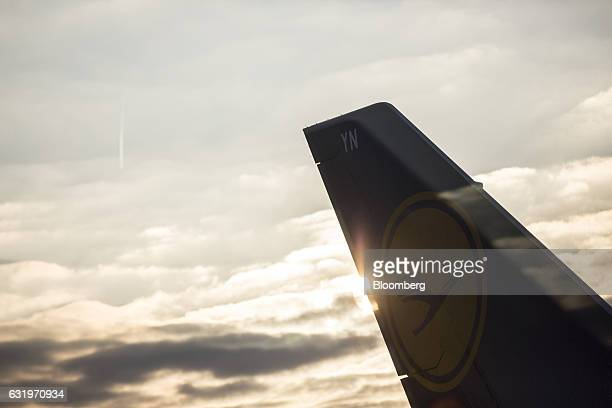 The Deutsche Lufthansa AG logo sits on the tail fin of a passenger jet as seen from the new VIP lounge at Frankfurt airport operated by Fraport AG in...