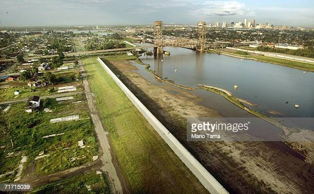 The devastated Lower Ninth Ward lies next to the repaired Industrial Canal levee wall with the city skyline in the background August 25 2006 in New...