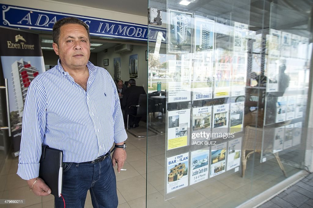 The developer and real estate agent Paul Bismith leaves his office, on March 20, 2014 in the city of Netanya in Israel. Bismuth, a former high-school friend of Thierry Herzog, had his identity borrowed to open a second phone line to Nicolas Sarkozy, whose private telephone conversations with his lawyer Herzog have been legally traced. AFP PHOTO / JACK GUEZ