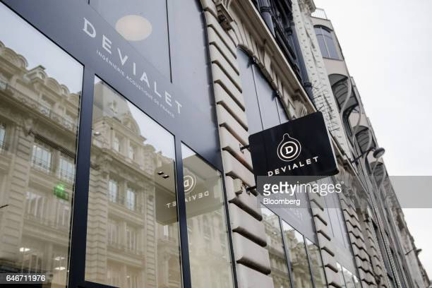 The Devialet SAS logo sits on a sign outside the Analogue Digital Hybrid amplification technology company's showroom in Paris France on Friday Jan 27...