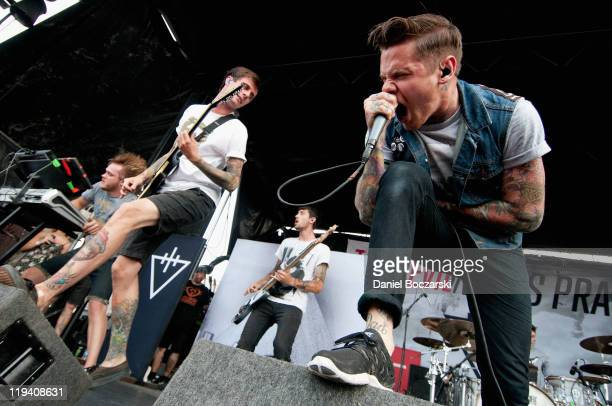 The Devil Wears Prada perform on stage during Vans Warped Tour 2011 at Marcus Amphitheatre on July 19 2011 in Milwaukee United States