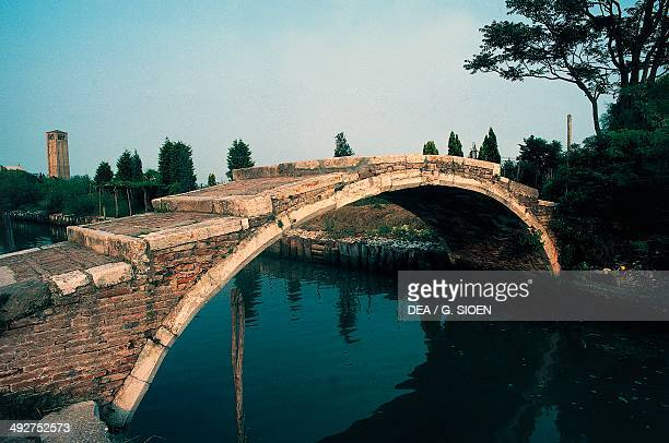 The Devil's Bridge over the Grand canal on Torcello island Venice Lagoon Veneto Italy
