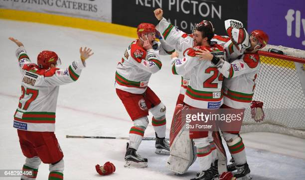The Devils players celebrate on the final whistle after beating the Sheffield Steelers 32 during the Ice Hockey Elite League Challenge Cup Final...