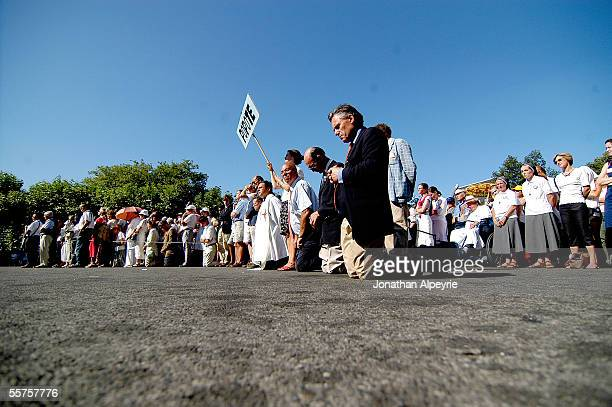 The devout pray during an outdoor mass on August 15 2005 in France Yearly thousands of Catholic pilgrims visit the underground Basilica of Saint Pius...