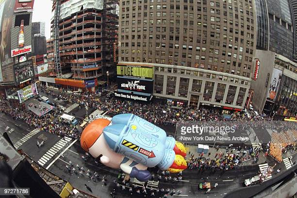 The Dexter balloon makes his way through Times Square during the 73rd annual Macy's Thanksgiving Day Parade