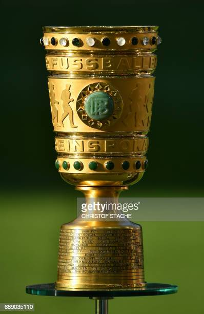 The DFB trophy is on display prior to the German Cup final football match Eintracht Frankfurt v BVB Borussia Dortmund at the Olympic stadium in...